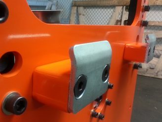 <p>We know rugged, shown is an impact pad to assist a jib crane operator in the loading of a fabrication in a rotary stage we designed.</p>